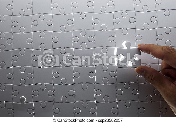 puzzle piece coming down into it's - csp23582257
