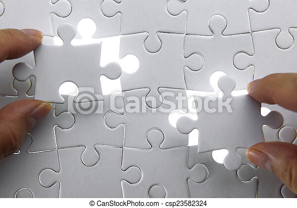 puzzle piece coming down into it's - csp23582324