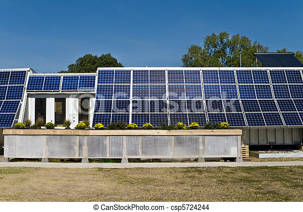 PV Solar Panel Array Mounted on Home Blue Sky - csp5724244