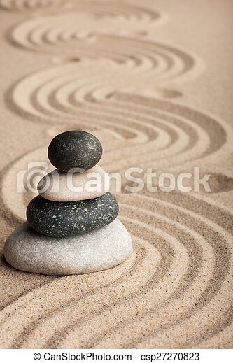 Pyramid  made of  stones standing on the sand - csp27270823