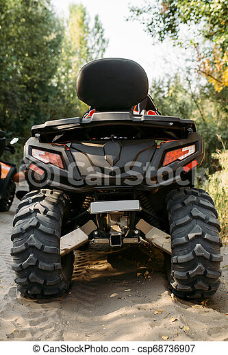 Quad bike in the forest, back view, nobody - csp68736907