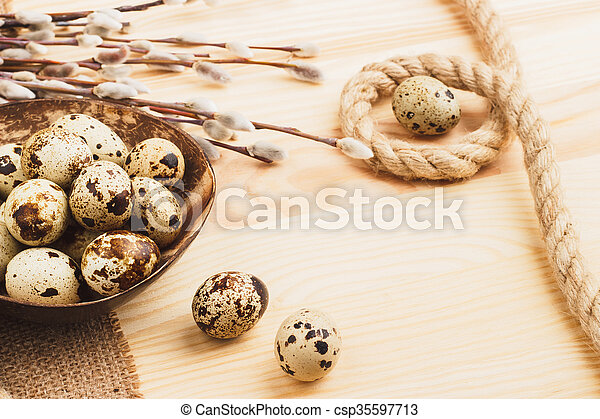 Quail Easter eggs in the bowl - csp35597713