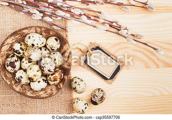 Quail Easter eggs in the bowl - csp35597706