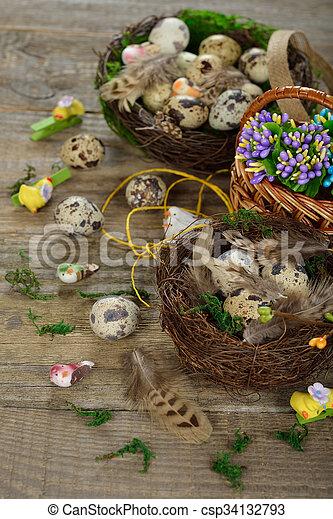 Quail eggs in a nest - csp34132793