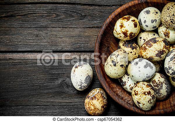 Quail eggs in the bowl. - csp67054362
