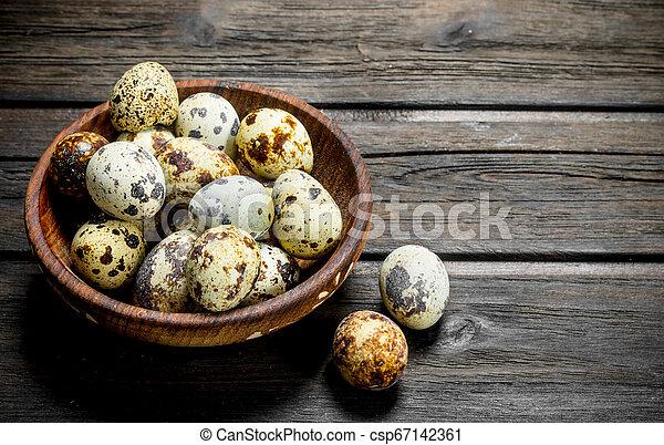 Quail eggs in the bowl. - csp67142361