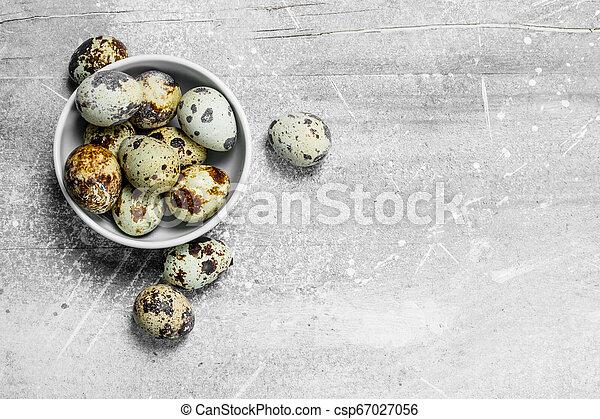 Quail eggs in the bowl. - csp67027056