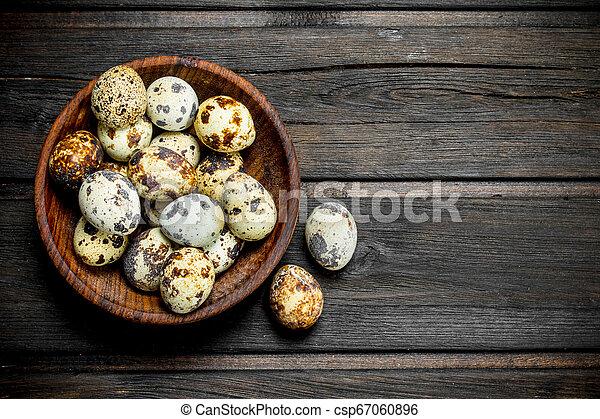 Quail eggs in the bowl. - csp67060896
