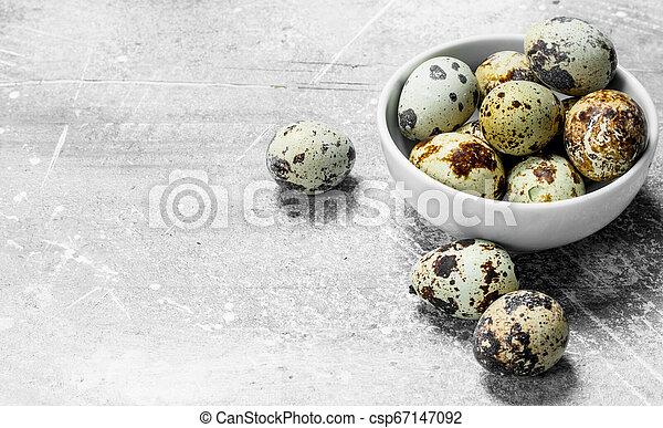 Quail eggs in the bowl. - csp67147092