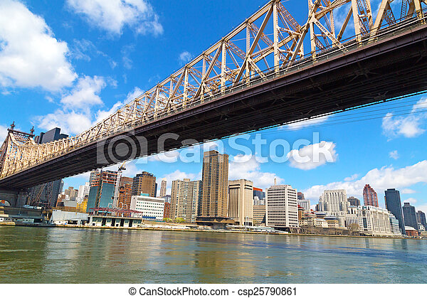 Queensboro Bridge and view on Manhattan from Roosevelt Island in spring. The bridge over East River in New York. - csp25790861