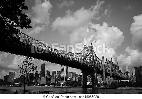 Queensboro bridge over the river and buildings in black and white style, New York - csp44066920