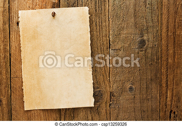 Un viejo y rústico letrero de vaquero en pergamino - csp13259326