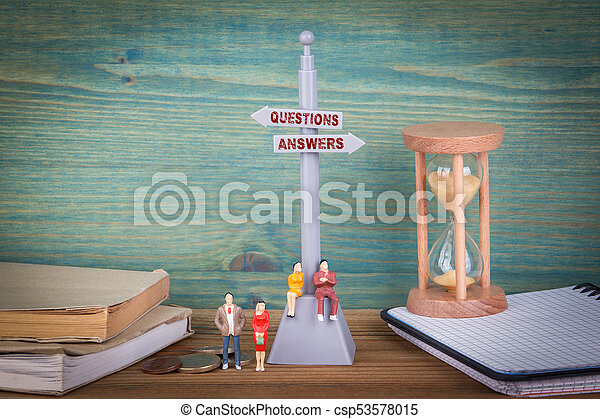 questions and answers. Signpost on wooden table - csp53578015