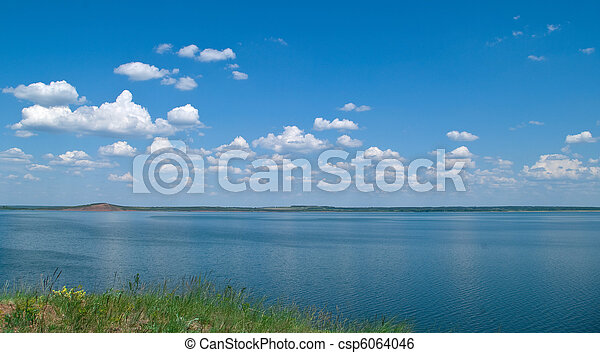 quiet water of lake and cloudy sky - csp6064046