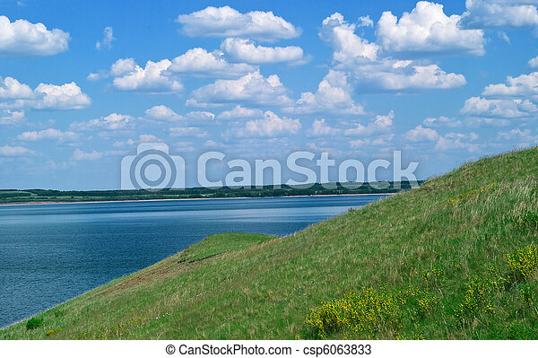 quiet water of lake and cloudy sky - csp6063833