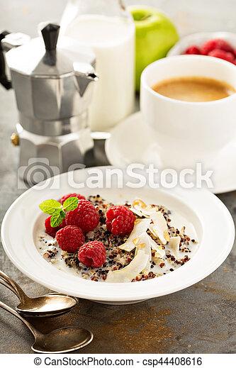 Quinoa porridge with raspberry and coconut flakes - csp44408616