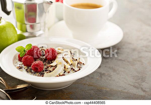 Quinoa porridge with raspberry and coconut flakes - csp44408565
