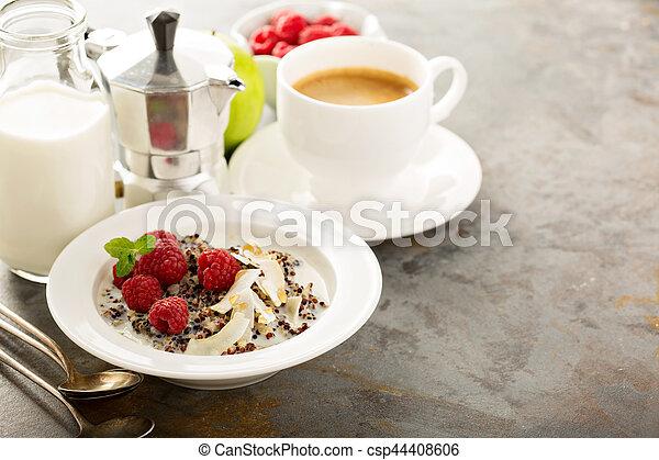 Quinoa porridge with raspberry and coconut flakes - csp44408606