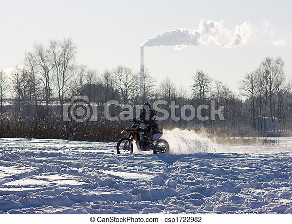 race on a motorcycle in the winter - csp1722982