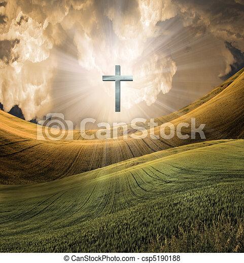 La cruz irradia luz en el cielo - csp5190188