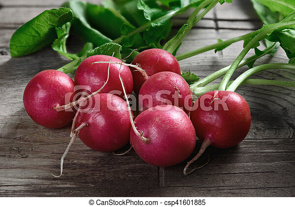radishes on a wooden table - csp41601885