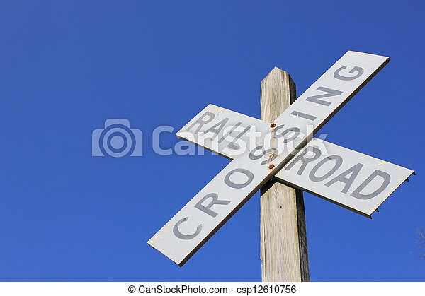 Railroad crossing sign and blue sky