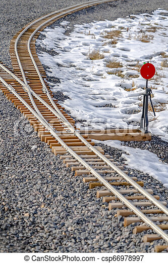Railroad switch on a railroad junction in winter - csp66978997