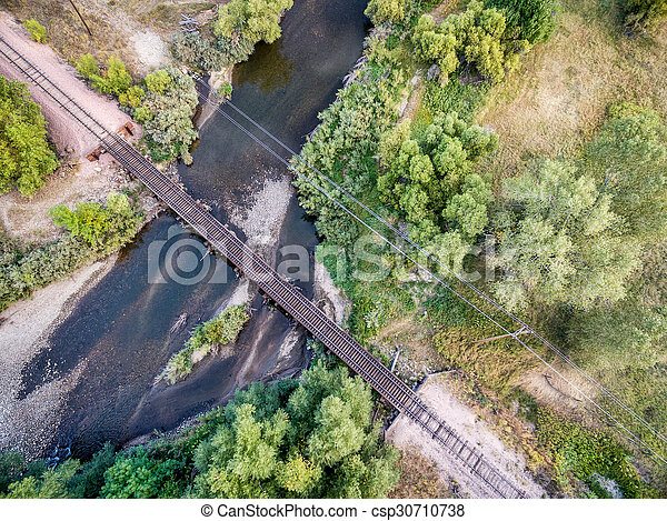 railroad tracks and river aerial view - csp30710738