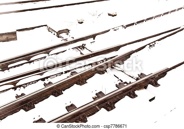 Railroad tracks in Winter with snow - csp7786671