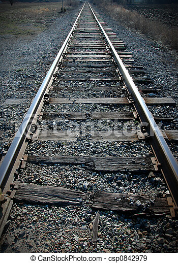 Old railroad tracks with broken grungy wood