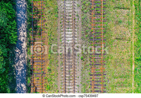 Railroad tracks with wooden sleepers and concrete, aerial view. - csp75439497