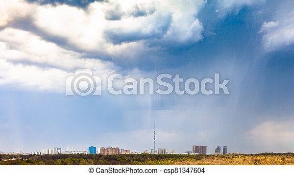 rain and rainy clouds over city and park in spring - csp81347604