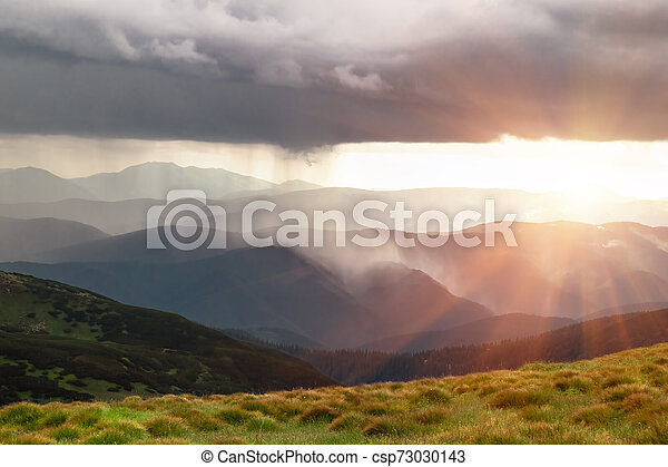 Rain and sun in the mountains. Natural phenomena - csp73030143