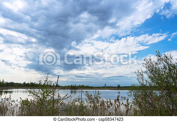 rain clouds over the lake - csp58347423