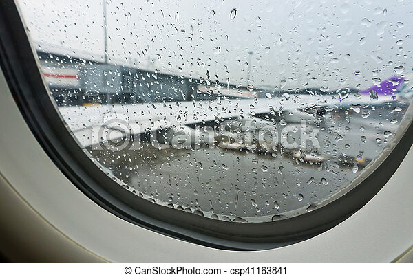 Selective Focus Rain Drop From Window Seat Inside Airplane With