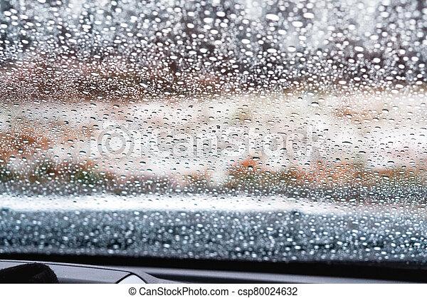 rain drops on glass, water drops on car glass - csp80024632