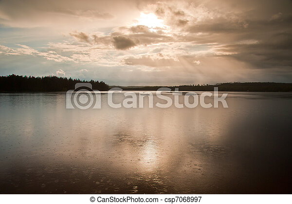 Rain over a lake in Sweden - csp7068997