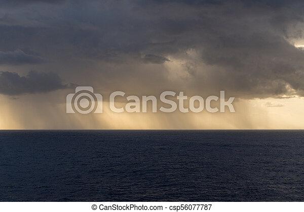 Rain over the Atlantic ocean from heavy storm clouds - csp56077787