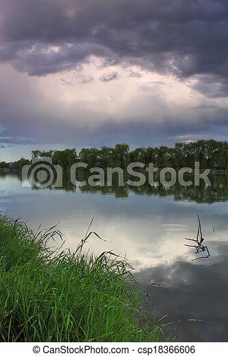 Rain over the lake - csp18366606