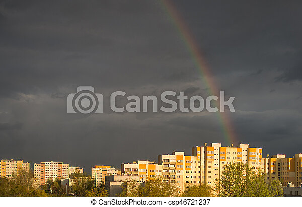 Rainbow, amazing view after rain in the city - csp46721237