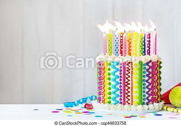 Amazing Rainbow Birthday Cake Rainbow Cake With Colorful Candles Funny Birthday Cards Online Alyptdamsfinfo