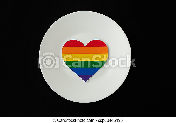 rainbow heart on a white plate, black background - csp80446495