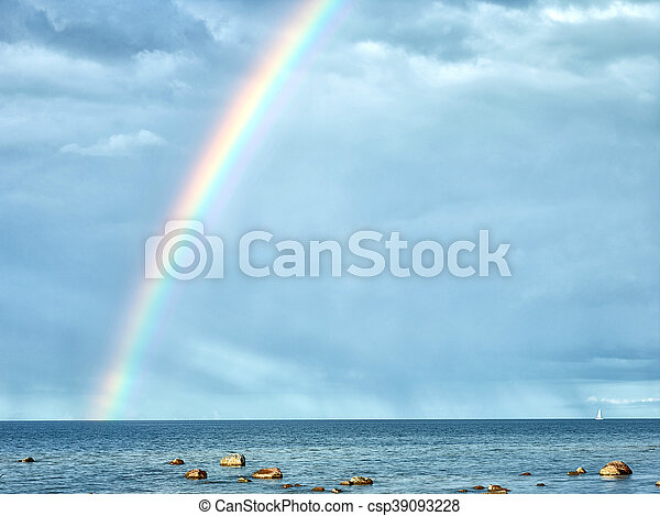 rainbow in cloudy sky after the rain - csp39093228