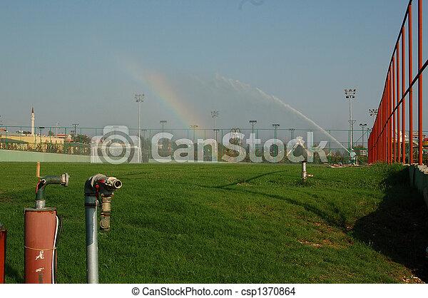 rainbow on a golf course - csp1370864