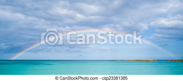 Rainbow over ocean - csp23381385