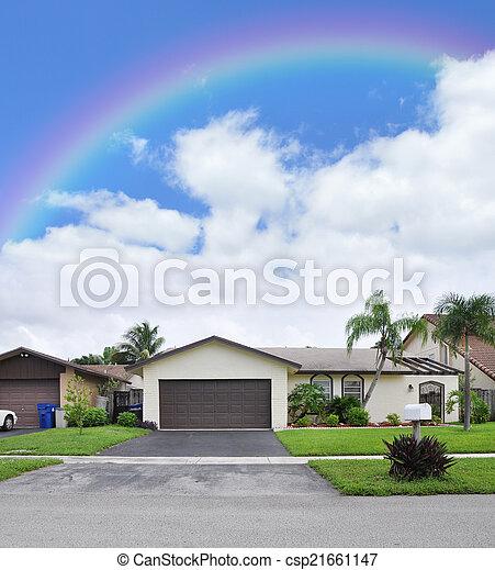 Rainbow over Suburban Home - csp21661147