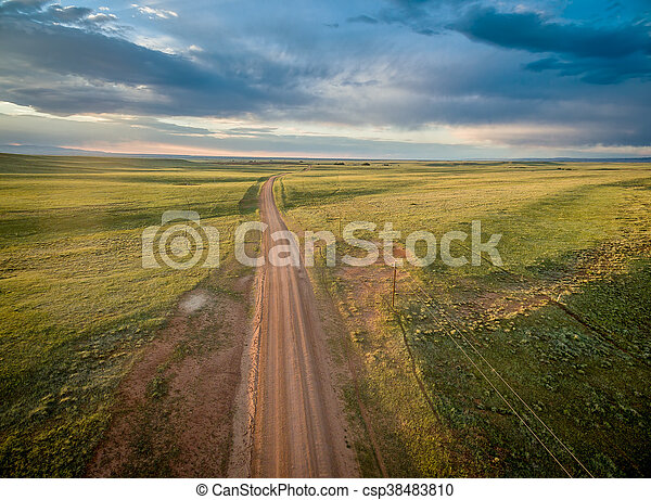 ranch road over Wyoming prairie - csp38483810