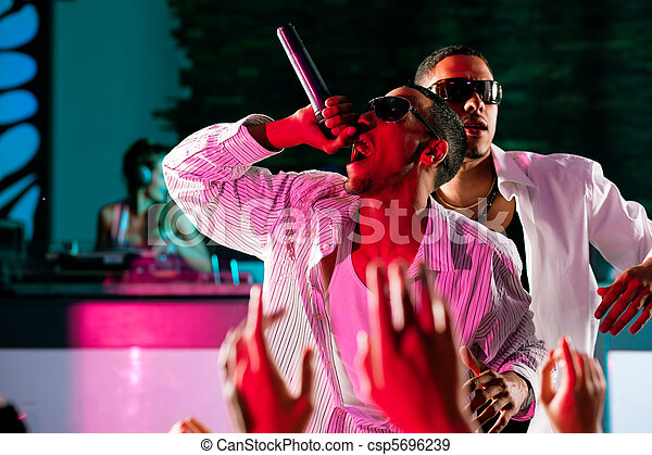 Rap or Hip-Hop Musicians performing on stage - csp5696239