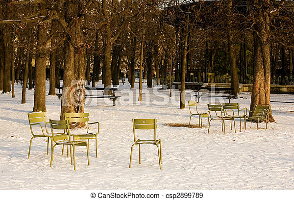 Rare snowy day in Paris. Lots of snow and chairs in the Luxembourg Garden - csp2899789