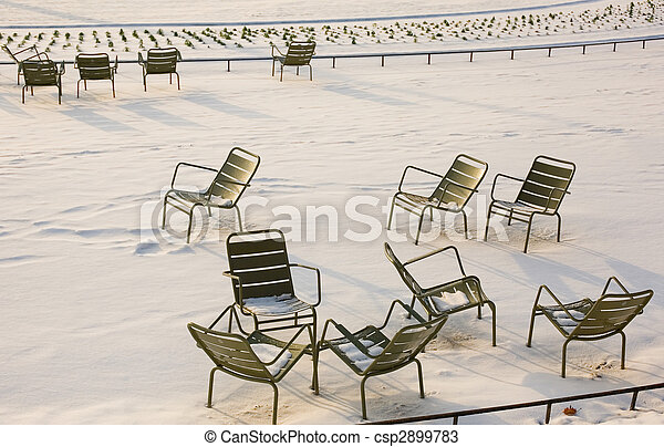 Rare snowy day in Paris. Lots of snow and chairs in the Luxembourg Garden - csp2899783